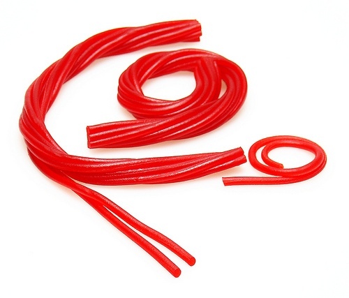 Use Twizzlers Pull & Peels to teach knot tying for 1st Year Camp Certification!