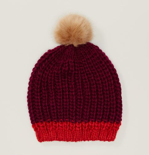 A plush faux fur pom pom tops this cozy color pop hat with a playful kind of luxe.