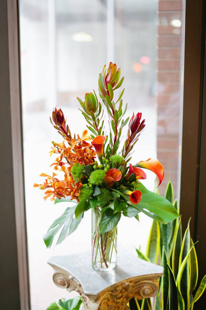 This exotic, warm-hued arrangement features speckled orange mokara orchids, tropical safari sunsets, and vivid orange calla lilies. A truly stunning - and tall - display! From Nosegay Flower Shop via Bloompop