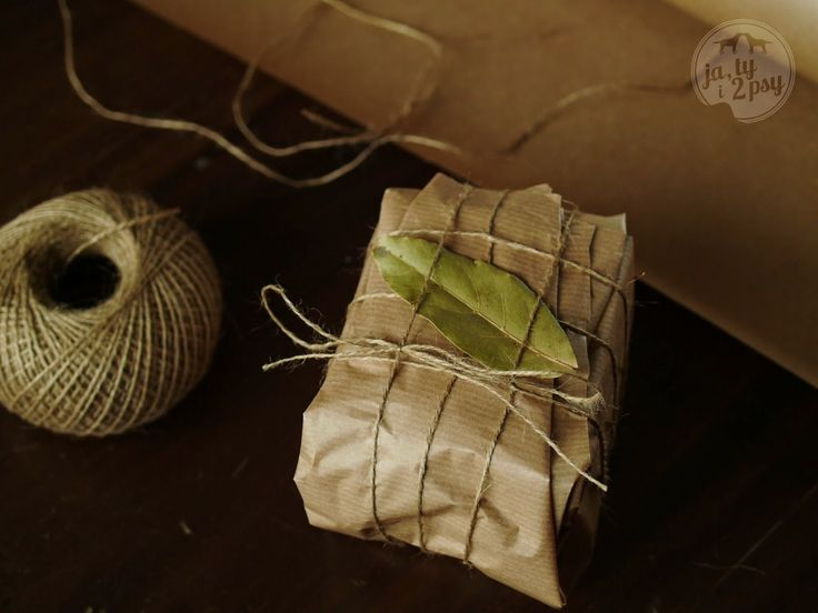 christmas presents packing - plain paper and dried herbs