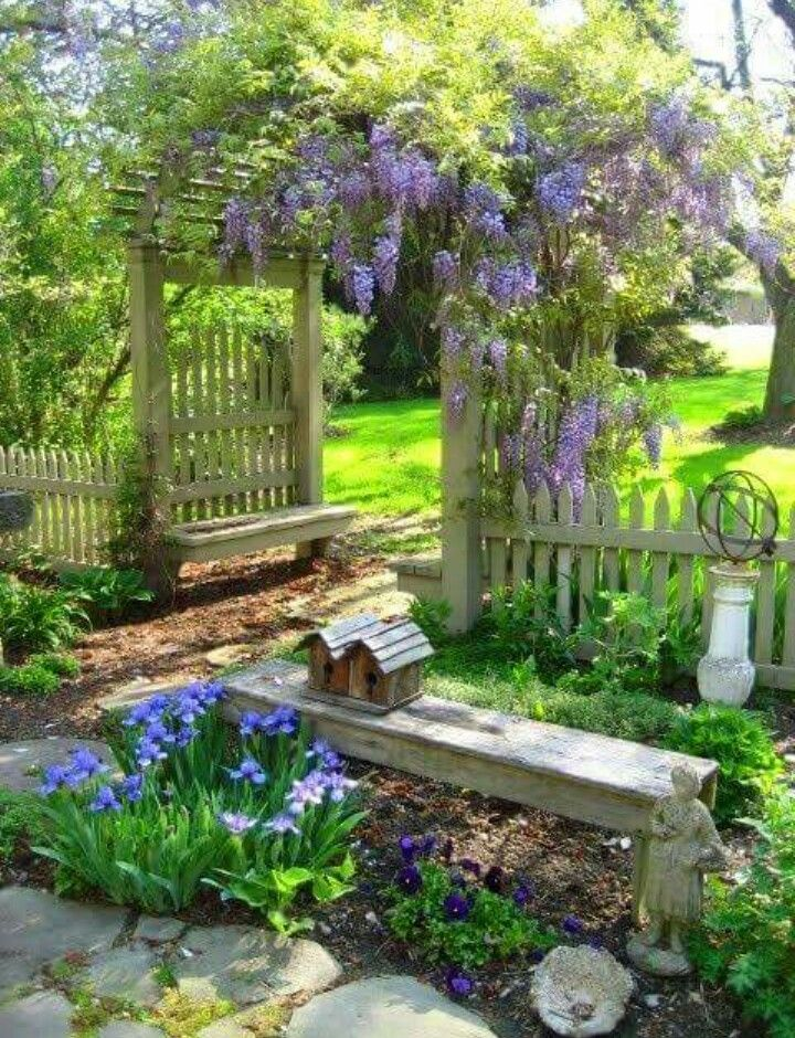 This is the look I want dividing my gardens. Love the wisteria over the arch.  Beckons people into the beyond.