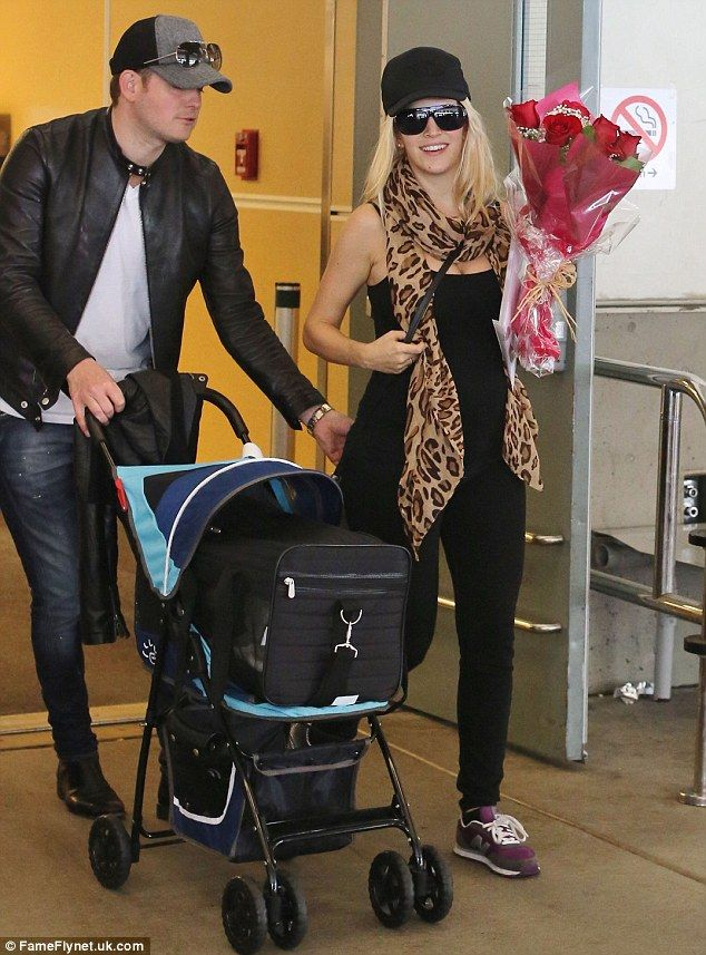 The model family: Michael Buble and his wife pregnant Luisana Lopilato are all smiles on Saturday