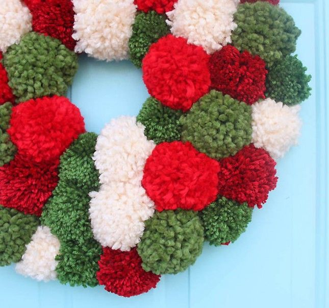 Welcome the holidays with a pom pom wreath.