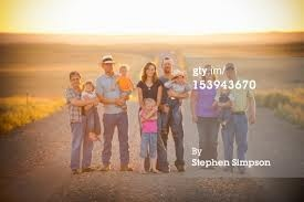 """farm family pictures - Why am I loving the standing in the middle of a road and seeing miles of what I love in the background?! Just screams """"home"""" to me :)"""