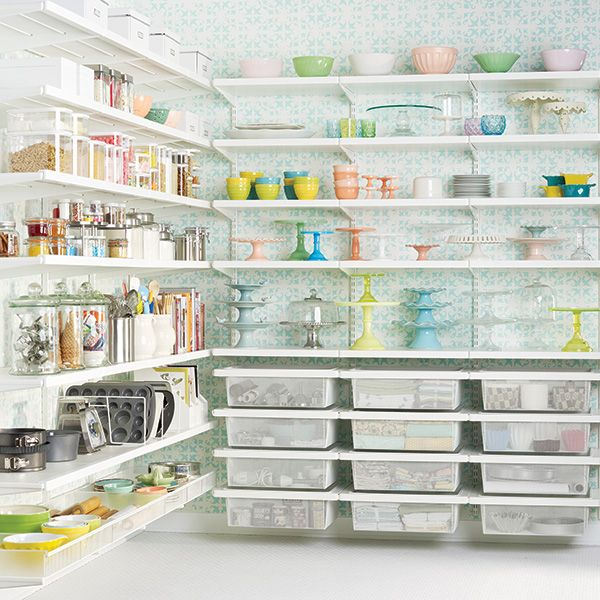 Elfa system pantry.  Love the rows of clear bins and the shelves with a front barrier