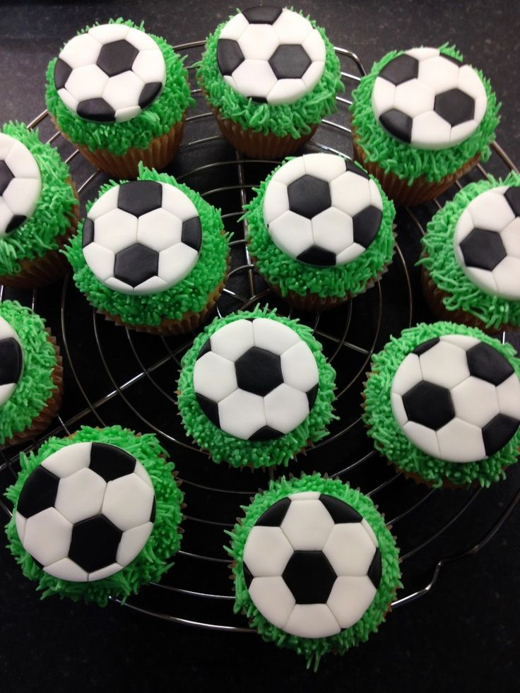 Fondant (sugar paste) football cupcake toppers with piped green grass
