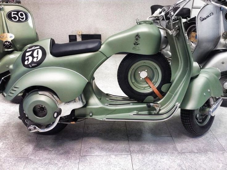 This Vespa was used during famous rallies in the 1950's: Sei Giorni (the six day trial Vespa). Details: extra tanks behind the saddle, extra support for the driver between the saddle and steering wheel plus a spare wheel,