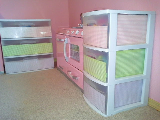 Adorable play kitchen with decorated plastic drawers!