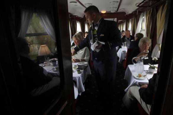 Lunch is served aboard a historic Tehran-bound train as it leaves Budapest October 15, 2014.  REUTERS/Bernadett Szabo visit http://www.budpocketguide.com #Iran #Persia #Tehran #Budapest #TravelToIran #MyIran #Travel2Budapest #MyBudapest
