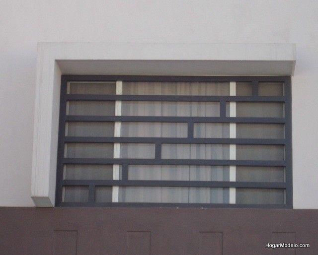 Fotografía de diseño de protecciones de ventanas elaboradas con rejas de herrería