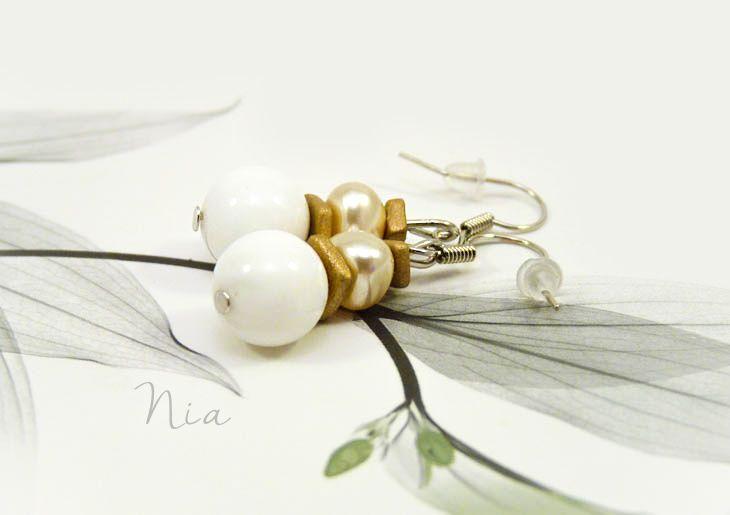 Cute little white jade and pearl earring. #nia