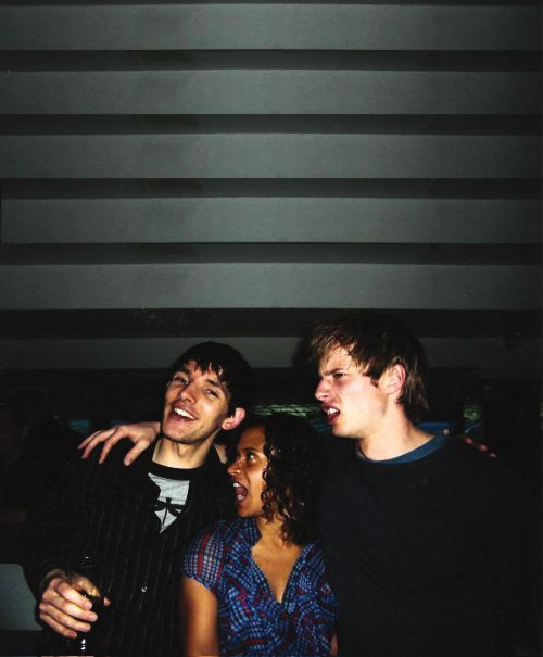 Colin Morgan< the super photogenic one, Angel Coulby< the 'I didn't realize someone was taking our picture, and Bradley James< the oh so definitely not photogenic type... but honestly this photo is so cute!!! <3