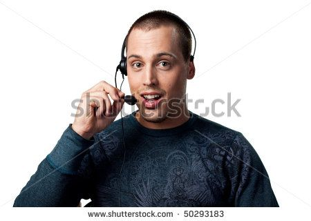 Happy call center worker smiling whilst talking to a customer