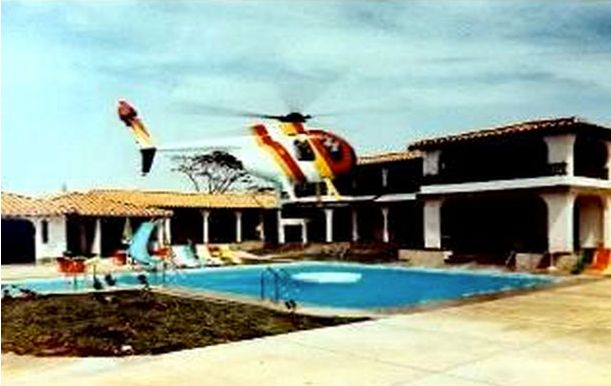 Pablo Escobar's toy helicopter and main house in the 80's. Description from simonsjamjar.com. I searched for this on bing.com/images