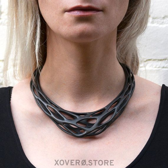 Gravity - 3d Printed Steel Necklace - Phyllotaxia Series:  The steel version of our Gravity necklace makes a maximum impression. Gravity is the first necklace in our Phyllotaxia series. By draping our Phyllotaxia pattern around the bust, we created this intriguing yet effortless statement piece. This model is made from 3d printed 420 Stainless Steel. Once 3d printing is complete the model is then infused with bronze for added strength. It has a final composition of approximately 60% steel…