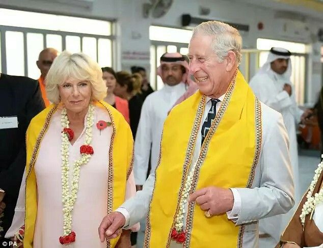 Charles and Camilla share a giggle at the Krishna Temple, in Manama, the capital city of Bahrain, on Thursday. The pair are visiting the country on behalf of the British government  Read more: http://www.dailymail.co.uk/femail/article-3922896/The-Duchess-Cornwall-stuns-pink-kaftan-Bahrain.html#ixzz4PeplUEMS  Follow us: @MailOnline on Twitter | DailyMail on Facebook