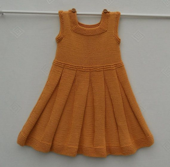 Dress or pinafore/tunic, for a baby girl or toddler,hand knitted in cool cotton…