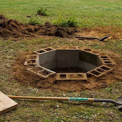 DIY In Ground Fire Pit Easy fire pit installation, then could be capped off with a nicer flat stone.