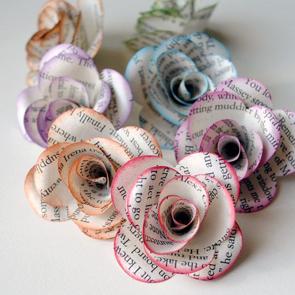 Book Paper Flowers: Make paper roses decorations to add an interesting twist to items including gifts and Christmas tree ornaments. To find out how to make your own paper rose, read this tutorial.  Source:Etsy user photomamaregina