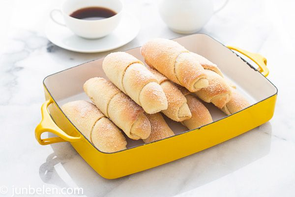 """How to make Spanish Bread {a popular Filipino sweet bread}   """"Soft. Luxuriously soft bread sticks coiled like croissants. Beautifully browned. Buttery and sweet."""""""
