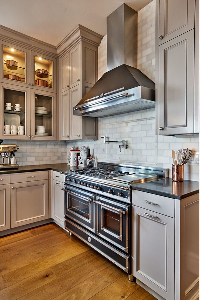 Gray cabinets to ceiling. Love this tile to ceiling also. From Beautiful Family Home with Traditional Interiors