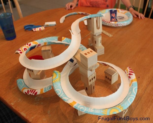 Paper Plate Marble Track - use heavy duty paper plates. cut sections, then overlap and tape the ends together to from one long twisting route. For supports, you can also use TP tubes in graduated lengths. To make a tunnel through a support, just cut an opening in it. Attach plates to tubes with glue dots.