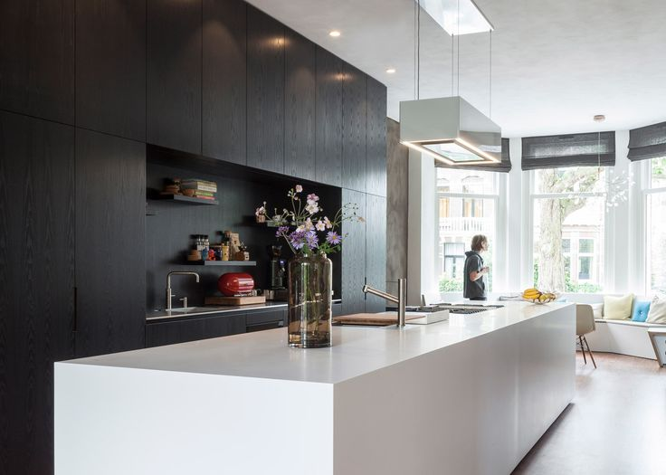 Architects Paul de Ruiter and Chris Collaris have transformed a former private museum in Rotterdam into an energy-neutral townhouse.
