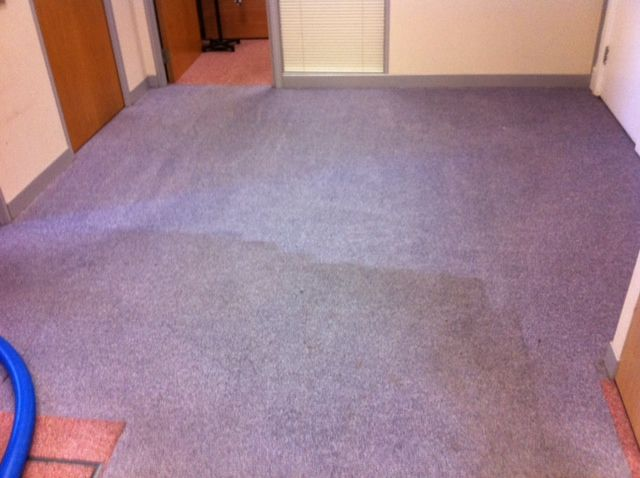 Commercial office carpet cleaning in Liverpool.  Here you can see a dramatic difference mid clean.  These Liverpool based accountants can now work in a much cleaner environment.