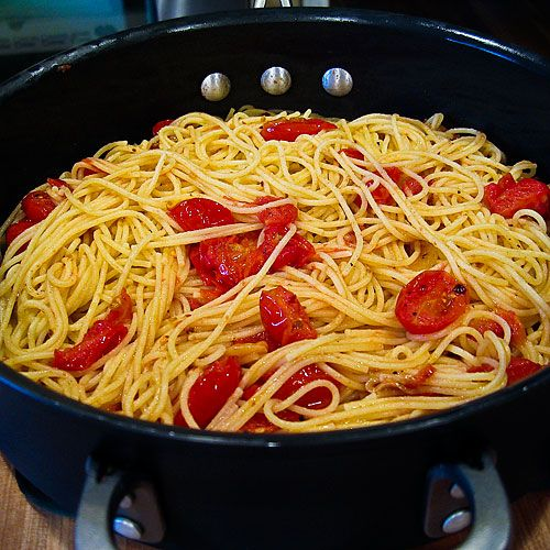 Pasta With Grape Tomatoes    VERY quick and delicious!  Half the red pepper flakes to make it more kid friendly.