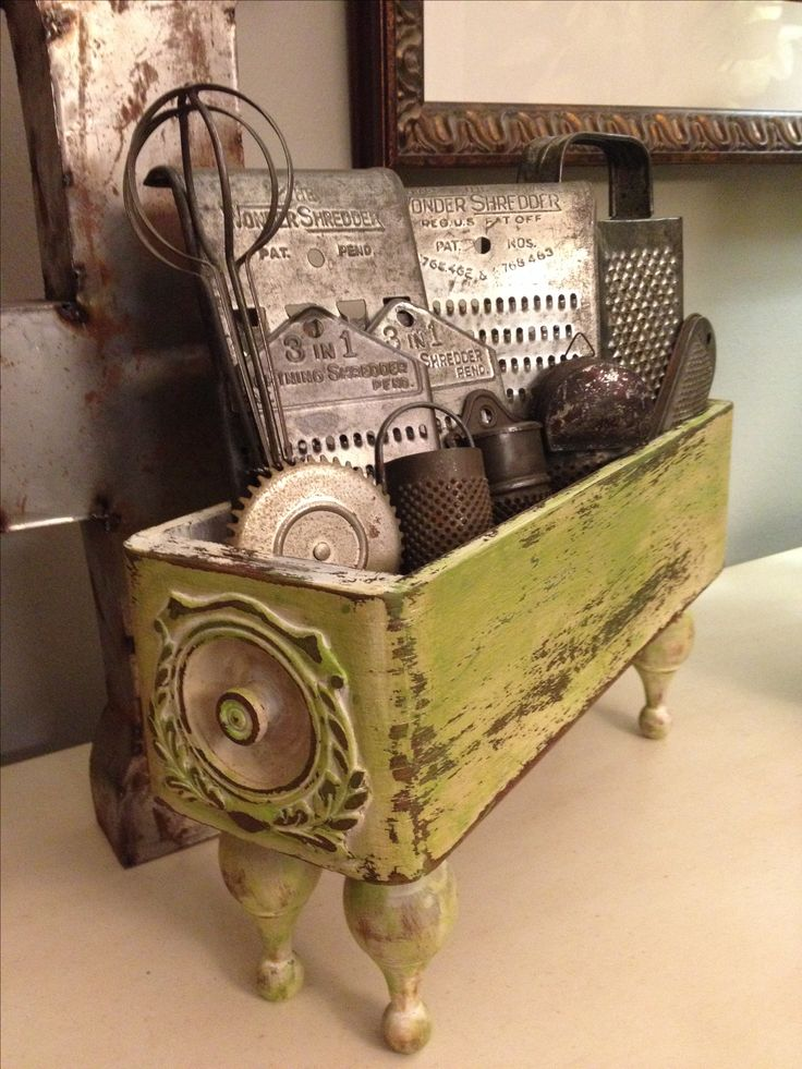 An old sewing machine drawer with short peg legs added & distressed paint to hold a collection.  Sweet!