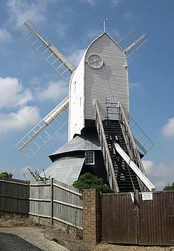 Windmill Hill Mill is a post mill at Herstmonceux, Sussex. It was built c. 1814 by Samuel Medhurst, the Lewes millwright. It was working by wind until 1893, when it was stopped owing to a weak weatherbeam. It is the largest post mill in Sussex, & is unique in that it is fitted with Hammond's Patent Sweep Governor, a feature previously fitted to Jack Mill, Clayton. After work by wind had ceased, milling was continued by means of a steam-powered mill set up in the roundhouse.
