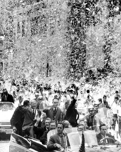 Neil Armstrong, the first man to walk on the moon, Buzz Aldrin and Michael Collins receive a ticker-tape parade in New York City. Mayor John Lindsay waves to the crowd from the limo. August 13, 1969.