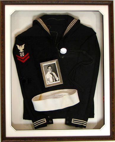A navy uniform.  We shadowboxed the uniform along with photos of the man who proudly wore it.  His daughter cried when she saw the finished product.
