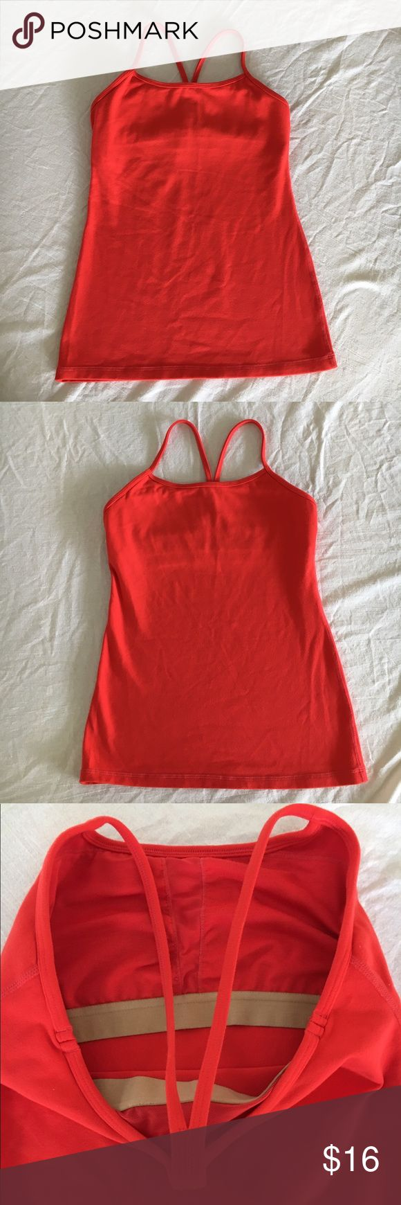 """LULULEMON ORANGE RED CAMI YOGA FITNESS TOP SZ 6 SZ 6 LULULEMON orangey red CAMI top. Pre owned, gently worn and in very good condition. No stains, holes, stretching, rips or odors. Smoke free home and environment. Built in bra. Does not come with inserts. Measurements: armpit to armpit flat side to side: 14"""" length from top of strap to bottom of top. 23"""". Thanks for stopping by! ☮️ Laura lululemon athletica Tops Camisoles"""