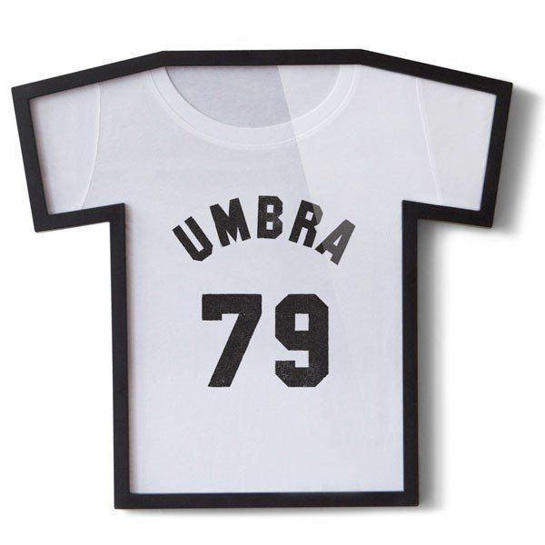 Umbra+T-Frame+T-Shirt+Frame+-+Store,+save+and+display+your+favourite+band+t-shirts,+football+shirts+and+souvenir+t+shirts+in+this+thoroughly+inventive+and+eye-catching+Umbra+T-Frame+T-Shirt+Frame.+ An+ideal+way+of+keeping+memorable+moments+close+to+you,+and+sprucing+up+your+walls+at+the+same+time,+this+t-shirt+display+is+probably+the+most+unusual+frame+in+our+entire+collection!  Just+whip+your+t-shirt+off,+fold+it+around+the+shaped+card+insert,+re-apply+the+backing,+and+pop+it+up+on+the+wal