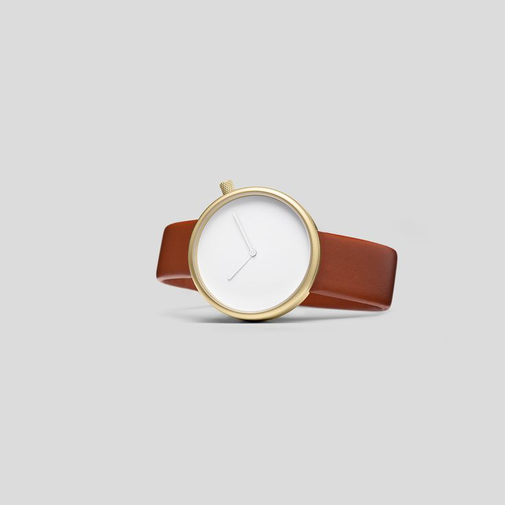 MATTE, GOLDEN STEEL ON BROWN, ITALIAN LEATHER.   Following the slightly asymmetric Pebble and the clean and contemporary Facette, the circular, minimalist Ore watch reduces timekeeping to its pure essence.
