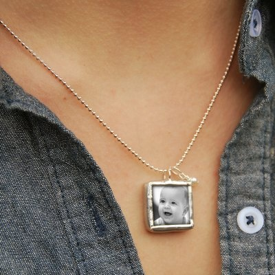 Consider a photo necklace featuring a pendant custom-made with your wee ones face.