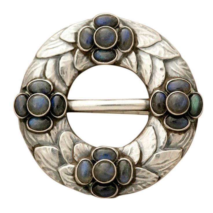 "GEORG JENSEN Brooch No. 4 with Labradorite | Georg Jensen early design sterling silver brooch no. 4 with labradorite cabuchon stones and exceptional detail and patina. 830 silver circa 1915-2; original clasp in cone shape; 1.5"" D."