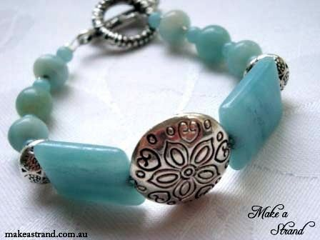 Round and rectanble blue amazonite beads are set with a sterling silver ornate round focal beads in this bracelet (sold)