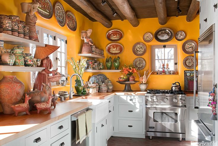 This is a dreamy kitchen! The owner says she doesn't cook in it though. Yellow Kitchen with Santa Fe Style - Southwest Kitchen Decor - House Beautiful