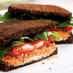 Salmon Salad Sandwich                        Combine salmon, onion, lemon juice, oil and pepper in a medium bowl. Spread 1 tablespoon cream cheese on each of 4 slices of bread. Spread 1/2 cup salmon salad over the cream cheese. Top with 2 tomato slices, a piece of lettuce and another slice of bread.