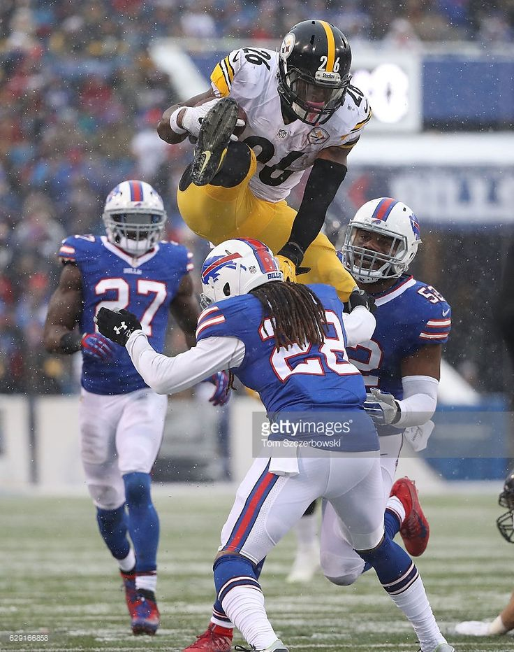 Le'Veon Bell #26 (Game stats: 236 yrds., 38 carries and 3 TDs.) of the Pittsburgh Steelers jumps over Ronald Darby #28 of the Buffalo Bills during the second half at New Era Field on December 11, 2016 in Orchard Park, New York.