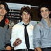 IMAGE ID # 1554389 Jonas Brothers' Kevin, Joe and Nick, visit Madrid Spain to present their latest work' A Little Bit Longer '. 'Today they were presented with the gold disc for sales of their first album, 'It's About Time'  10/06/2008 --- Nick Jonas, Visit, see, travel or tour in Spain. Wish you could go there too? imagine yourself making USD1000 a DAY! yes, per day! visiting these places are no longer a dream. click the picture, enter ur email address, and watch the video.