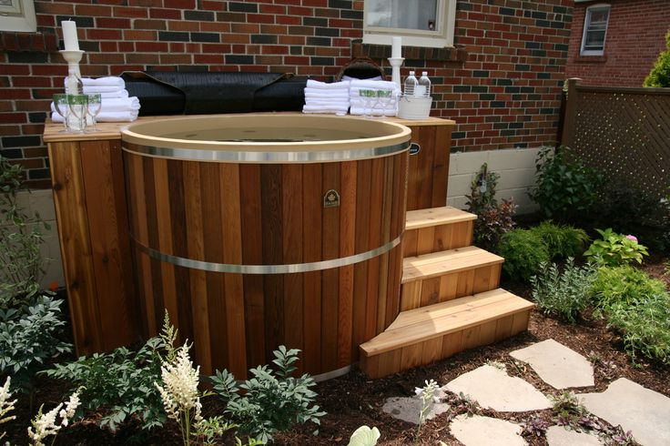 A 5' diameter, 4' deep round cedar hot tub. Perfect for couples and small families. All you need is a space of around 7' x 7'. Our cedar hot tubs are sold as kits and assembled onsite. Ideal for urban back yards or indoors in a basment or sunroom. Find out more at http://www.canhottub.com