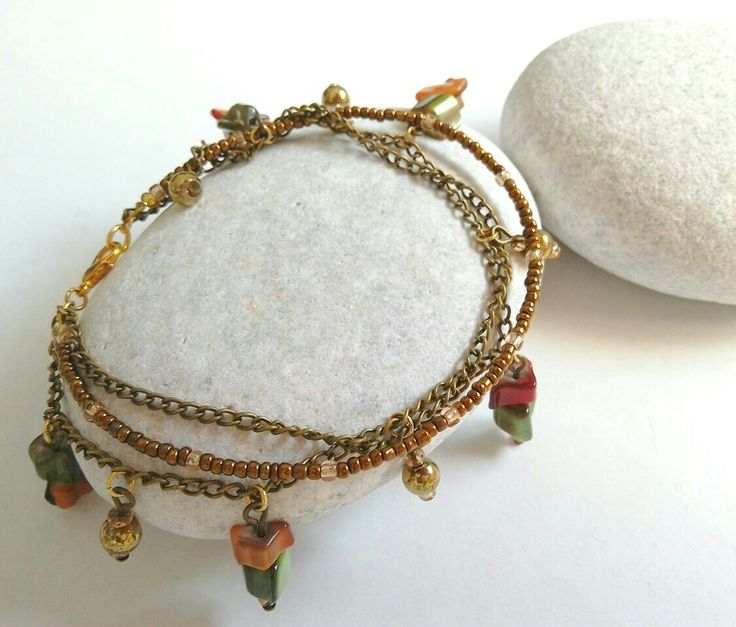 Ankle bracelet with bronze chain and shell charms. https://m.facebook.com/ElitasBijoux?ref=hl&__nodl