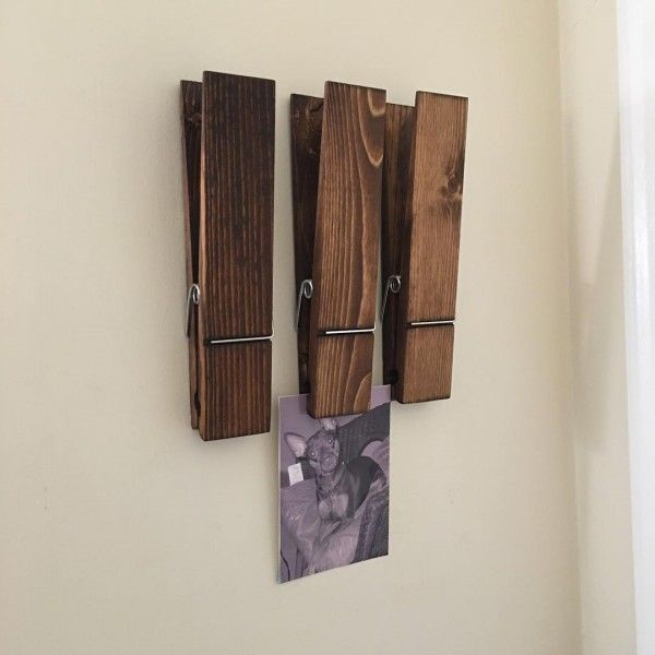 You have to see this #rustic wall decor idea with oversize clothespins. Love it! #HomeDecorIdeas @istandarddesign