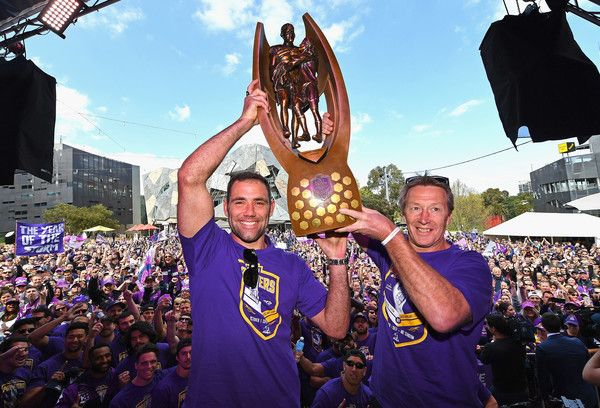 Cameron Smith and Craig Bellamy of the Storm hold up the NRL premiership trophy during the Melbourne Storm NRL Grand Final celebrations at Gosch's Paddock on October 2, 2017 in Melbourne, Australia. http://footyboys.com