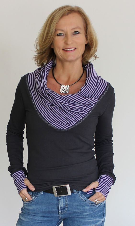 The neckline was cut a little deeper and then the contrast added. Notice that the neck piece is a simple rectangle as are the cuffs that were added to the sleeves.