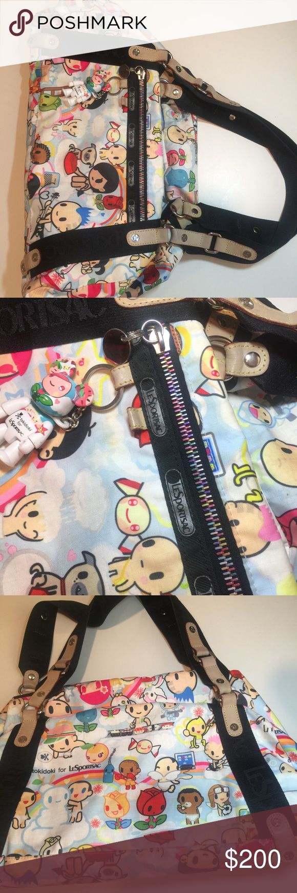 Tokidoki for LeSportsac Paradiso Gioco Purse Bag. Good used condition. A few pen marks in the interior and some easily cleaned dirt marks on fabric and leather from normal use. Comes with qee and is 100% authentic tokidoki Bags Satchels