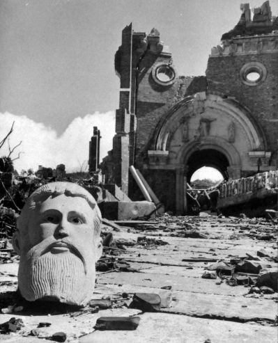 Bust in front of destroyed cathedral two miles from the atomic bomb detonation site, Nagasaki, Japan, 1945